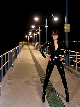 Mistress Tokyo in Gomu Latex and 9 inch platform thigh high boots.