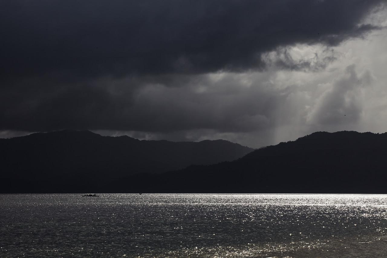 Dark clouds and silver sea