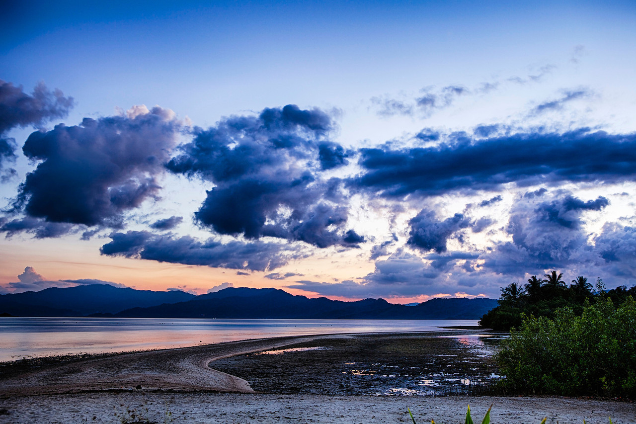 Sandbar under blue cloudscape