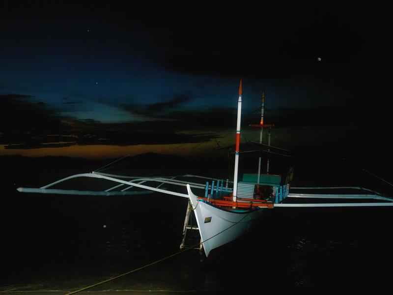 Moon over flashy boat