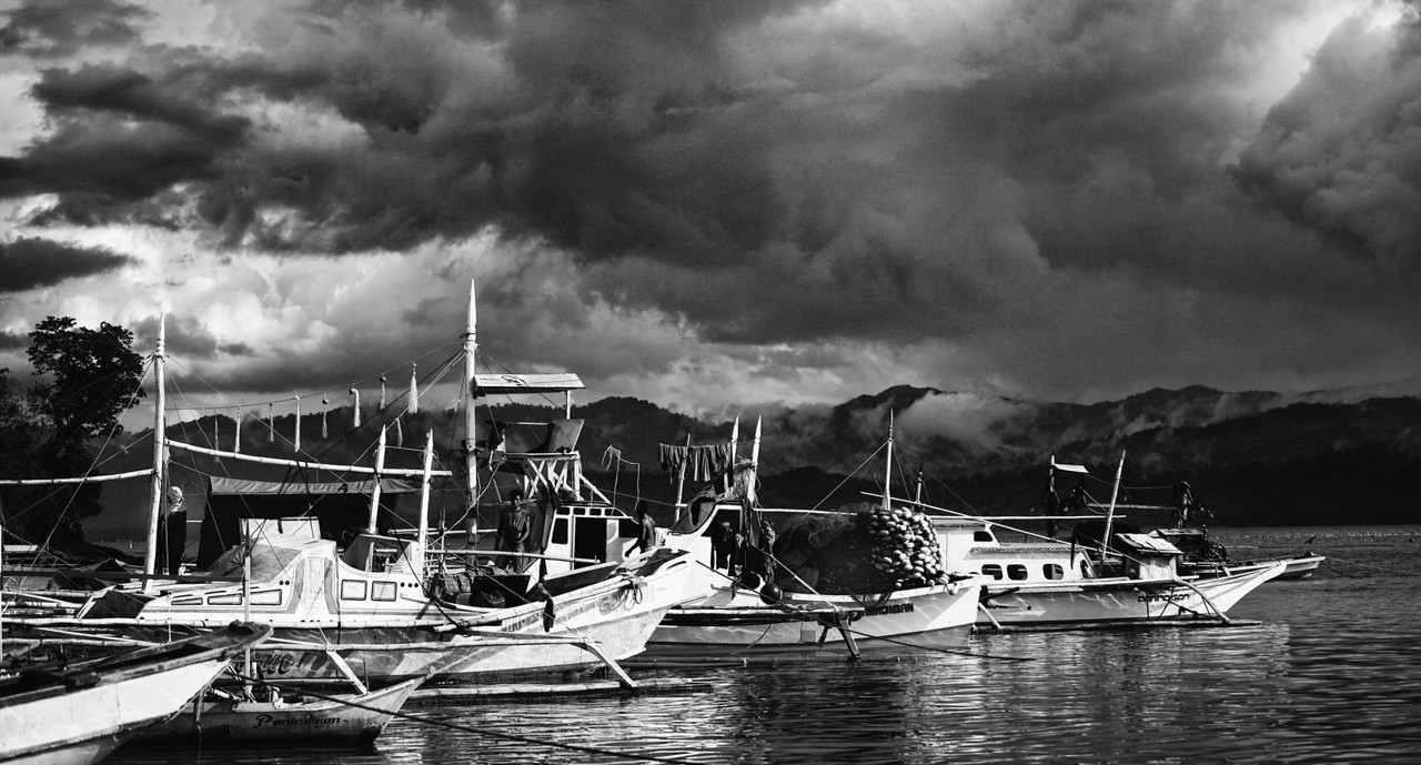 Fishing fleet and storm clouds