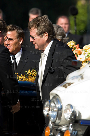 "LOS ANGELES . The life of ""Charlie's Angels"" star Farrah Fawcett is being celebrated at a private funeral in the Cathedral of Our Lady of the Angels in downtown Los Angeles.James Fawcett, father of late actress Farrah Fawcett arrives for her funeral and her longtime companion, Ryan O'Neal, was among pallbearers who accompanied the casket, covered in yellow and orange flowers, into the Roman Catholic cathedral Tuesday afternoon.(Photo by Michel Boutefeu)"