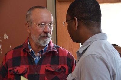 Fr. Byron Haaland, novice master, shares stories with Fr. Joseph Mukuna