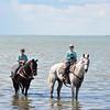 Boys on horseback in water