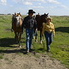 Ranchers lead their horses