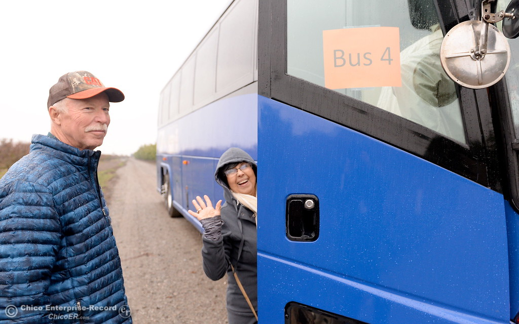 . At left, tour guide Doug Bentz prepares to get on the bus during the 2017 Farm City Bus Tour Wednesday Nov. 8, 2017. (Bill Husa -- Enterprise-Record)