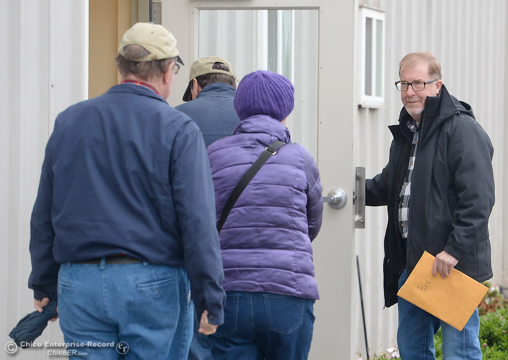 . Tour Guide Daniel Robinson holds the door for visitors at 4 Corners Hulling and Shelling during the 2017 Farm City Bus Tour Wednesday Nov. 8, 2017. (Bill Husa -- Enterprise-Record)