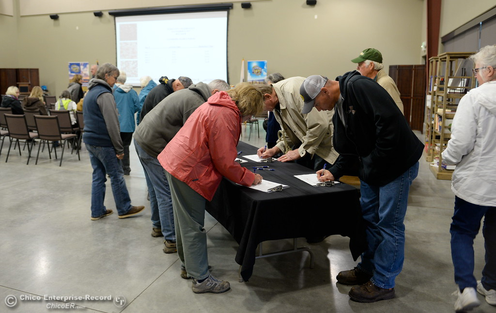 . Guests are asked to sign in as they arrive at Lundberg Family Farms during the 2017 Farm City Bus Tour Wednesday Nov. 8, 2017. (Bill Husa -- Enterprise-Record)