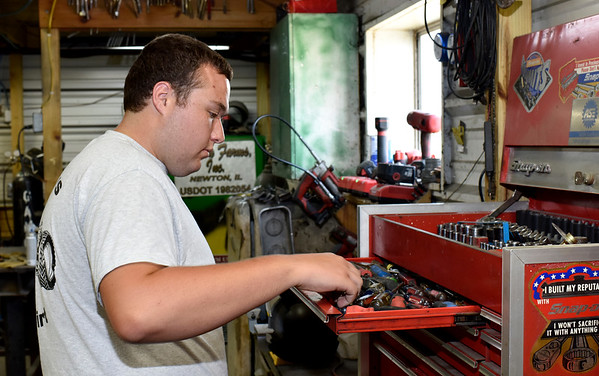 Ethan Matson plans to return to his family farm after graduating with a Bachelors degree in college. Matson is pictured working in the Matson Farms garage. Charles Mills photo