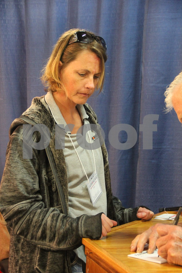 On Wednesday, December 2, and Thursday, December 3, 2015, The Farm News Ag Show was held at the Iowa Central Community College East campus, in Fort Dodge. Pictured here helping register attendees is  Christine Johnson.