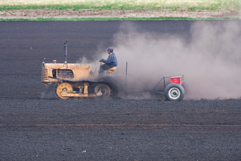 A farm worker near Pumpkin Swamp Road in Goshen preps the black dirt for the planting of this years onion seeds
