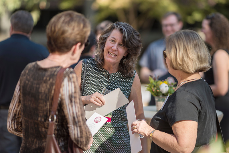 Development Director, Lise Smith-Peters (center) and Tower Society guests enjoy the Farm to Table event at the Warrens Reception Center on Saturday, October 7, 2017 in Chico, Calif.<br /> (Jason Halley/University Photographer)