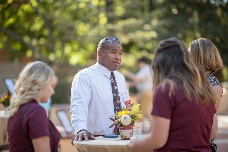 Robert Talley (center) talks with Tower Society guests enjoy the Farm to Table event at the Warrens Reception Center on Saturday, October 7, 2017 in Chico, Calif.<br /> (Jason Halley/University Photographer)