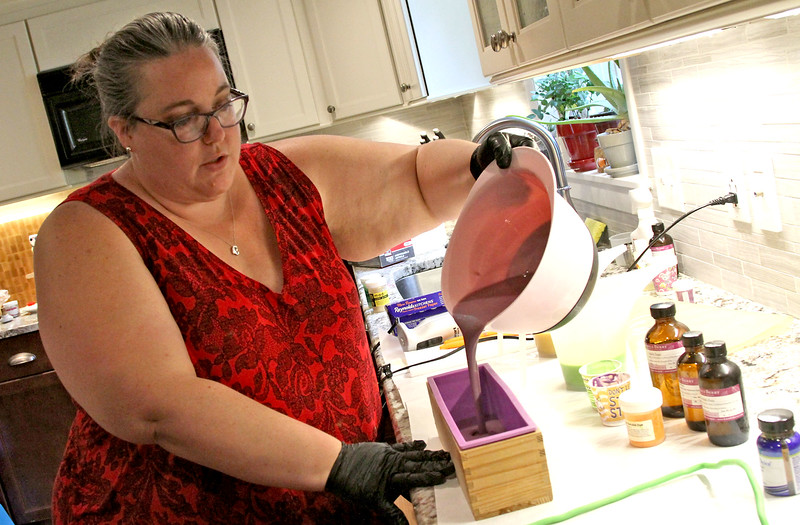 Meryll Pray of Wilmington, pours a mix into a mold for her hand made soap. SUN/David H. Brow