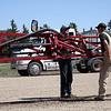 Farmers checking spraying equipment