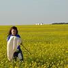 Farmer checks sweepnet in canola field