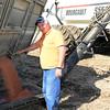 farmer filling seeder