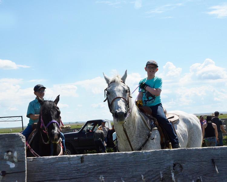 Boys on horseback