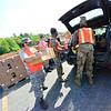 KRISTOPHER RADDER — BRATTLEBORO REFORMER<br /> Members of the Vermont National Guard load food boxes into vehicles at a Farmers to Families Food Box Distribution site at Brattleboro Union High School, in Brattleboro, Vt., on Wednesday, May 27, 2020.