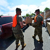 KRISTOPHER RADDER — BRATTLEBORO REFORMER<br /> Vermont National Guard PFC Culann Gage and Sgt. Scott Gordon help load food boxes into vehicles at a Farmers to Families Food Box Distribution site at Brattleboro Union High School, in Brattleboro, Vt., on Wednesday, May 27, 2020.