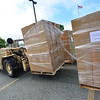 KRISTOPHER RADDER — BRATTLEBORO REFORMER<br /> A palette of food is moved into place at a Farmers to Families Food Box Distribution site at Brattleboro Union High School, in Brattleboro, Vt., on Wednesday, May 27, 2020.