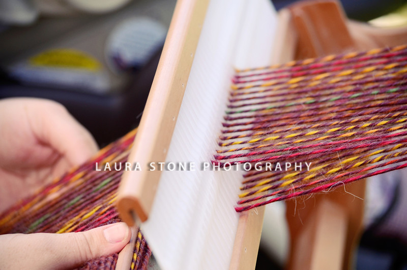 Weaving on a loom. Fiber Twist, 9/16/12.