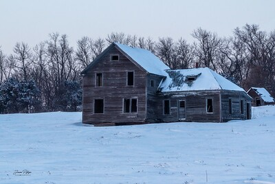 Abandoned farmhouse and shed in Northeastern South Dakota. Enjoy and hold hands.