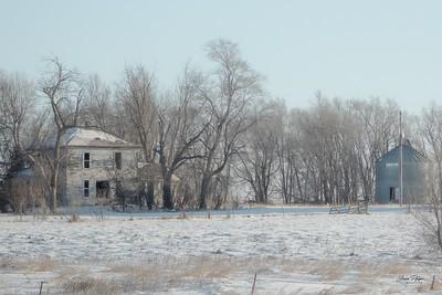 Abandoned farmhouse and silo in rural South Dakota.