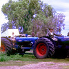 Horrie Ison (Snr) on lead Fordson tractor and Rod Ison on pusher unit.,  Next was Ford 8000 4x4