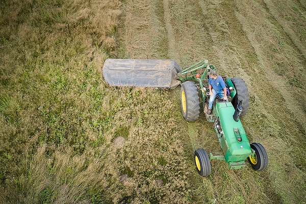 Aerial photo of tractor cutting hay