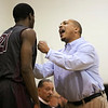 (Tuesday February 18th 2015 - Farmington High School - Farmington, MI - Athletic Gym) Hazel Park's #21 MT Toure speaks with head coach Brandon Barrett Tuesday night. Photo by: Brian Sevald