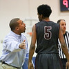 (Tuesday February 18th 2015 - Farmington High School - Farmington, MI - Athletic Gym) Hazel Park's #5 Caleb Dotson speaks with head coach Brandon Barrett Tuesday night. Photo by: Brian Sevald