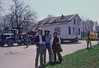 Proud new homeowners Jeff and Sherrie Stewart stand next to the Historic District Commission's Ruth Moehlman in front of their new house as the traffic lights are moved to allow the house to make the turn onto 13 Mile Road. The woman in the yellow coat in the background was given the 2nd historic Botsford Inn house that was moved to the West side of Drake Road a few hundred yards South of Howard Road.