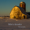 I took this picture just after sunrise near Jewell, Iowa.  The next two pictures are of the same barn taken right before sunset.
