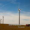 These wind turbines and farm vehicle were taken in Hamilton County, Iowa during Fall harvest.