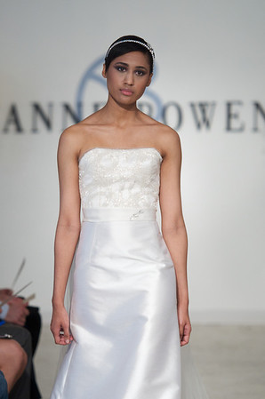 Virtue, an orchid white crystal beaded bodice, silk and wool strapless A-line gown with tulle train, clear crystal belt, from Anne Bowen's Spring 2013 Collection called Coat of Arms.