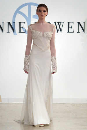 Valor, an ivory silk beaded chiffon detail, Chantilly lace, long sleeve net gown, from Anne Bowen's Spring 2013 Collection called Coat of Arms.