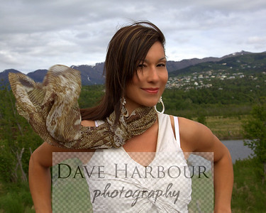 Beautiful Alaska Native woman, coy, sky and mountain marsh, Potters Marsh, Anchorage, Alaska