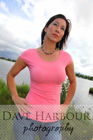 Beautiful Alaska Native woman, georgous figure, pensive, sky and lake background, Lake Hood, Alaska.  Vertical: excellent for magazine cover.