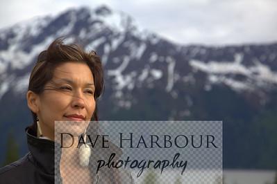 Beautiful Alaska Native woman, sad, black leather jacket, sky background, mountains, turnagain arm, Anchorage, Alaska, beautiful Alaska Native hand crafted earrings