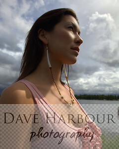 Beautiful Alaska Native woman at lake under clouds, soft light.  Vertical: excellent for magazine cover.