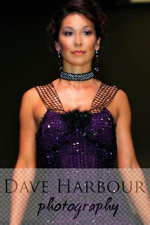 Beautiful Alaska Native woman, fashion show, Anchorage Alaska, Clare 2 Clare Fundraiser for Catholic Social Services, full torso vertical