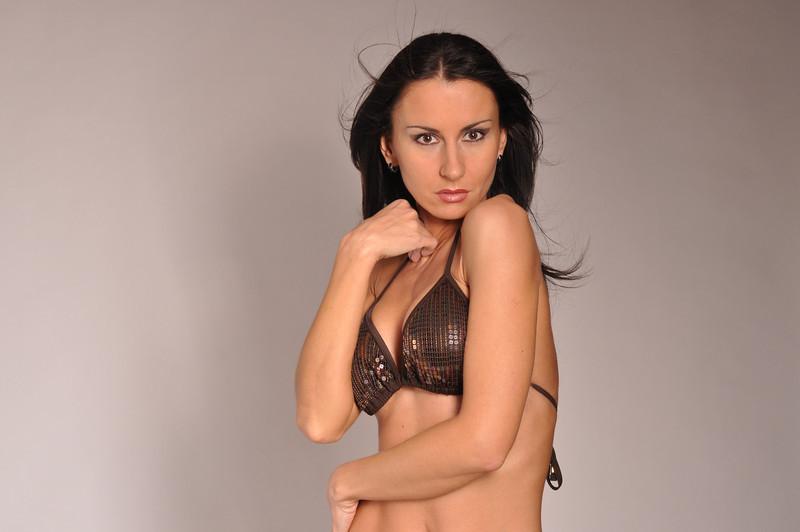 Photoshooting with a brown bikini