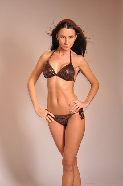 Photoshooting with a brown bikini