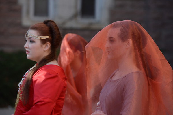 """Miranda Sigley, left, Cat Mapson, back,  and Laura Reed, get into position for the photo shoot.<br /> Members of the University of Colorado Fashion Design Association had a photo shoot at Old Main on Sunday to preview their fashion show that will be held Dec. 1, 2012, at 7 p.m. at the Glenn Miller Ballroom.<br /> For more photos from the fashion design club, go to  <a href=""""http://www.dailycamera.com"""">http://www.dailycamera.com</a>.<br /> Cliff Grassmick  / November 25, 2012"""