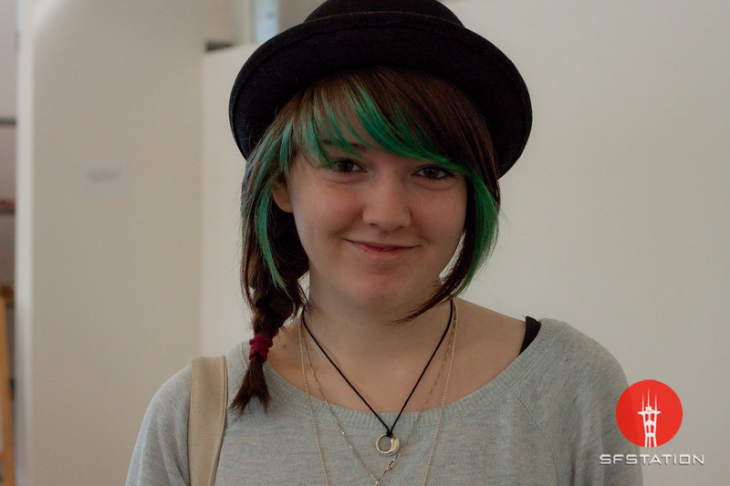 Photo by Tessa Morris<br /> <br /> In this scene: Alora is studying writing and literature at CCA. I love the combination of her hair coloring, side-braid, and hat.