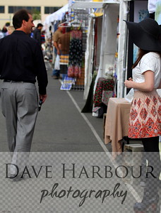 Chloë Akers fashions Alaska handicrafts, is completing her college education and looking forward to a life on the Last Frontier.  In this photo: beautiful young market vendor watches handsome customer leave forever.  Both appear to be wishing for something to say to the other.  (Photo release not yet available; photo may be used only for art, editorial, personal purposes.)