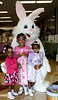Three of the models of the Easter Fashio n Parade, Sa'riyah Stinyard, Caparia Powell and D'Nai Hampton, pose with the Easter Bunny during the silent auction part of the event. Mike Adam