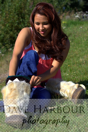 Felicia Nayokpuk is an extremely attractive, pleasant and intelligent young Alaskan woman.  A resident of Anchorage, she is proud of her Alaska Native heritage and strives to make the most of her talents.  Here she is pulling on a pair of Alaska North Slope Inupiaq Mukluks, made of reindeer and walrus hide.