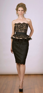 French lace bustier with removable peplum-belt, matching lace skirt.